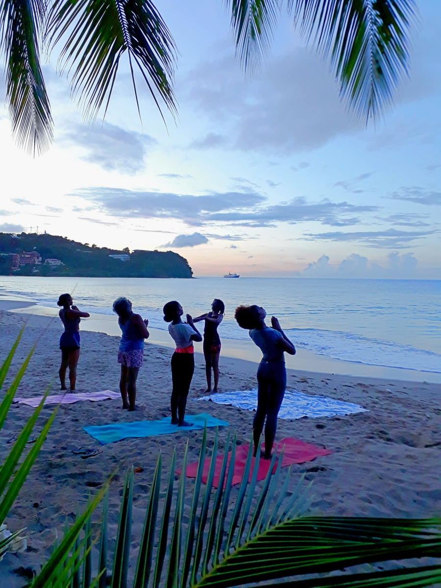 Sun Salutations Yoga on the Beach in Paradise What to do in St Lucia