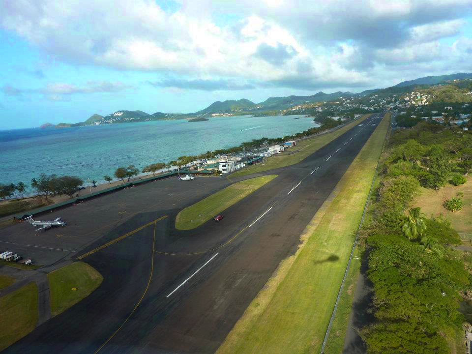 Arriving at Vigie (George F L Charles) Airport in Saint Lucia - right next to a beautiful beach with the hills of Rodney Bay in the distance