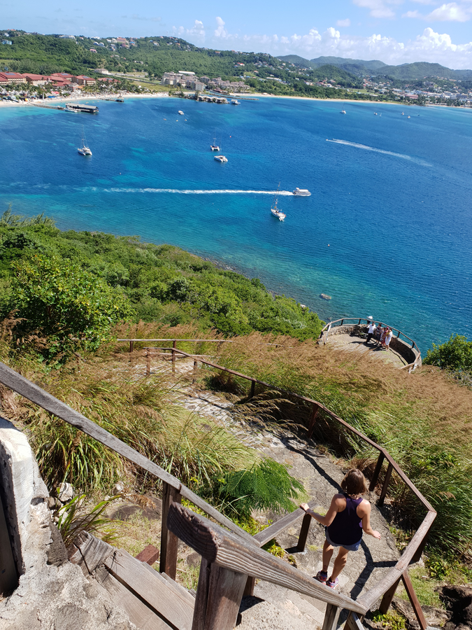 The view coming down from Fort Rodney on the Saint Lucia National Trust's Pigeon Island National Landmark. The hills of Rodney Bay and beyond make a stunning instagram shot! In this photo you can see Sandals Grande Hotel and the Landings on the Pigeon Causeway