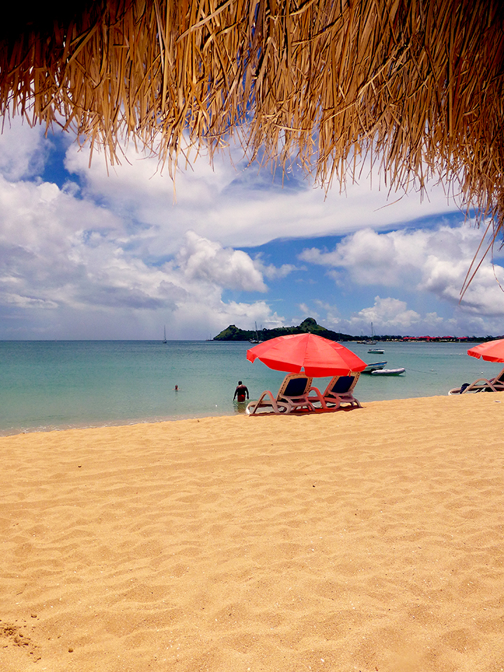 pristine blue sea and golden sand beach at Rodney Bay, Saint Lucia, Reduit beach, relax, swim, dive, snorkel, suntan, enjoy a beach bar or watersports