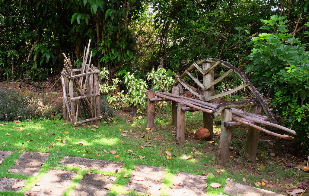 rustic benches at the entrance to Mamiku Gardens and historical estate on the east coast of saint lucia
